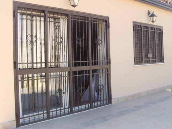 Arena costruzione infissi serramenti e infissi in pvc alluminio ferro acciaio enna sicilia foto - Finestre in ferro battuto ...